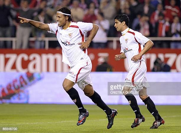 Sevilla's Luis Fabiano celebrates with Renato Dirnei after scoring against Valladolid with their Spanish league football match at the Sanchez Pizjuan...