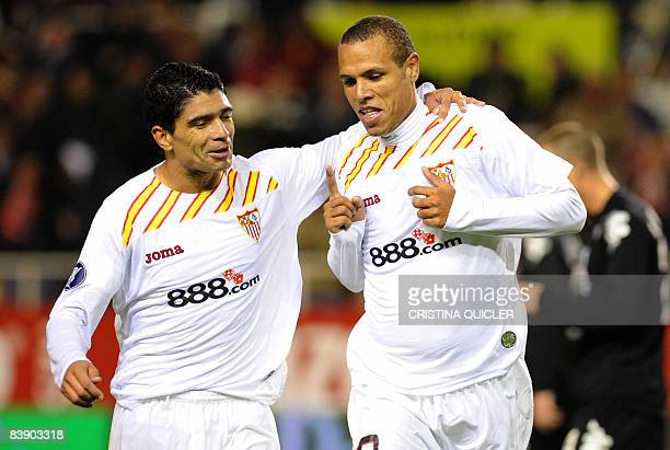 Sevilla's Luis Fabiano celebrates with teammate Renato Dirnei after scoring against Partizan Belgrade during their UEFA Cup football match at the...