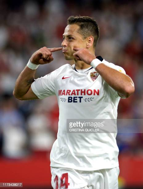 Sevilla's Mexican forward Chicharito celebrates after scoring a goal during the UEFA Europa League group A football match between Sevilla and APOEL...