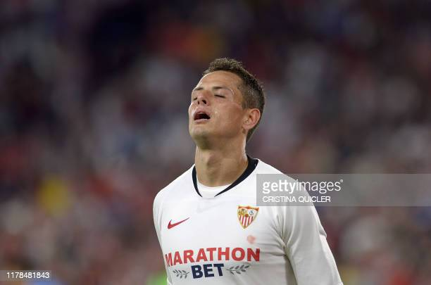 Sevilla's Mexican forward Chicharito celebrates after scoring a goal during the Spanish league football match between Sevilla FC and Getafe CF at the...