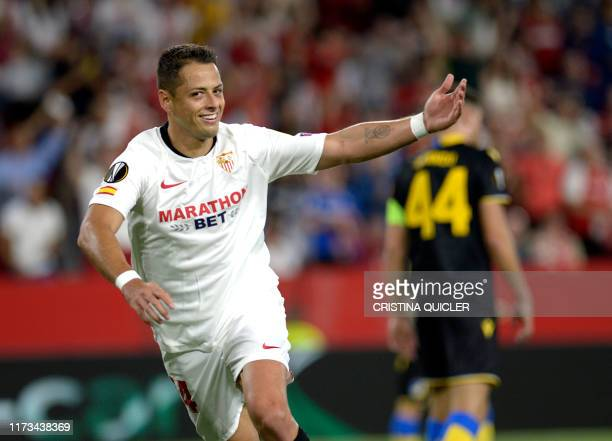 Sevilla's Mexican forward Chicharito celebrates after scoring during the UEFA Europa League group A football match between Sevilla and APOEL Nicosia...