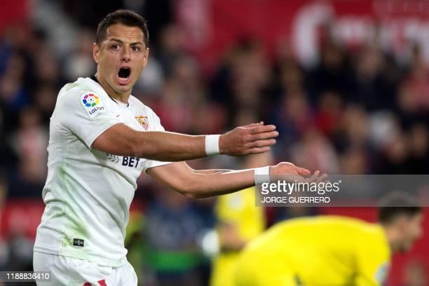 Sevilla's Mexican forward Chicharito reacts during the Spanish league football match between Sevilla FC and Villarreal CF at the Ramon Sanchez...