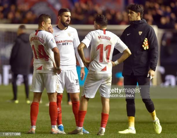 Sevilla's Mexican forward Chicharito Sevilla's Israeli forward Moanes Dabour Sevilla's Spanish forward Munir El Haddadi and Sevilla's Moroccan...