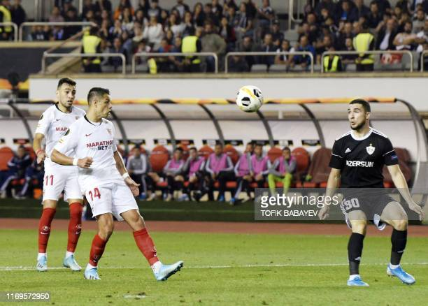 Sevilla's Mexican forward Javier Hernandez and Qarabag's Azerbaijani defender Abbas Huseynov vie for the ball during the UEFA Europa League Group A...
