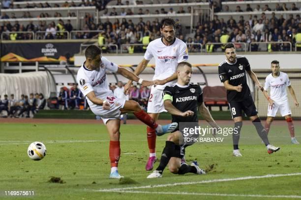 Sevilla's Mexican forward Javier Hernandez and Qarabag's Azerbaijani defender Maksim Medvedev vie for the ball during the UEFA Europa League Group A...