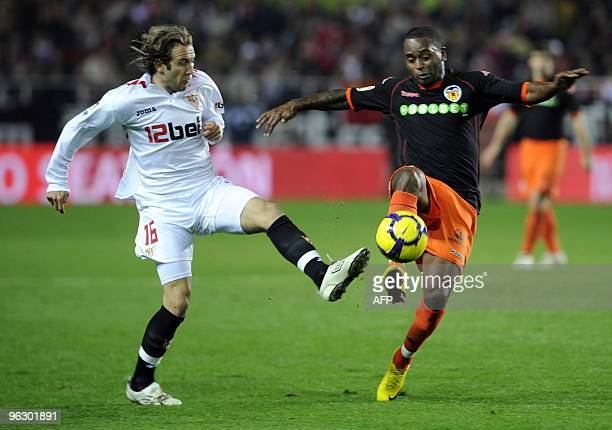 Sevilla's midfielder Diego Capel vies with Valencia's Portuguese defender Miguel Monteiro during a Spanish league football match at Sanchez Pizjuan...