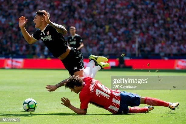 Sevilla's midfielder from Argentina Joaquin Correa vies with Atletico Madrid's defender from Croatia Sime Vrsaljko during the Spanish league football...