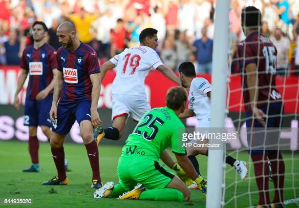 Sevilla's midfielder from Brazil Ganso celebrates after scoring a goal during the Spanish Liga football match Sevilla FC vs SD Eibar at the Ramon...