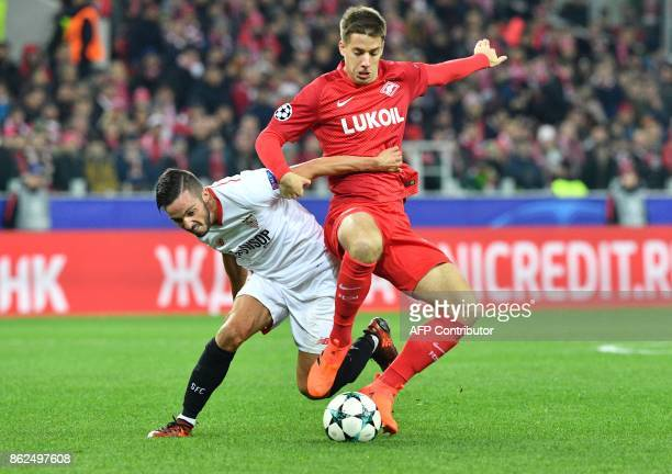 Sevilla's midfielder from Spain Pablo Sarabia and Spartak Moscow's midfielder from Croatia Mario Pasalic vie for the ball during the UEFA Champions...