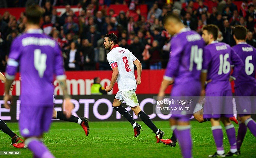 Sevilla's midfielder Iborra (C) celebrates after scoring during the Spanish Copa del Rey (King's Cup) round of 16 second leg football match Sevilla FC vs Real Madrid CF at the Ramon Sanchez Pizjuan stadium in Sevilla on January 12, 2017. / AFP / CRISTINA
