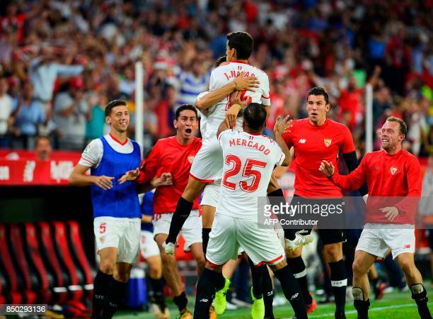 Sevilla's midfielder Jesus Navas celebrates a goal with teammates during the Spanish league football match Sevilla FC against UD Las Palmas at the...