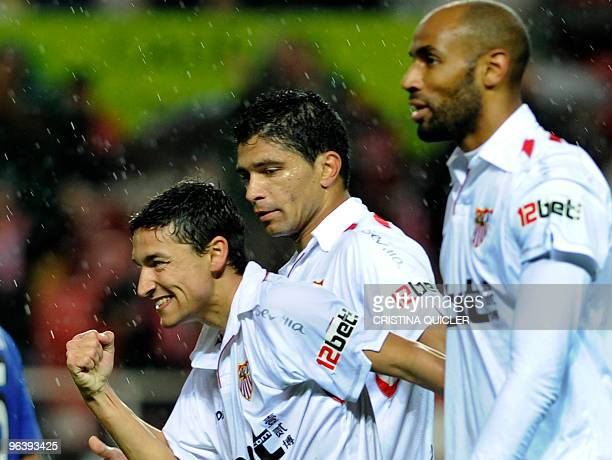 Sevilla's midfielder Jesus Navas celebrates after scoring against Getafe with Sevilla's Malian forward Frederic Kanoute and Sevilla's Brazilian...