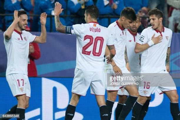 Sevilla's midfielder Pablo Sarabia celebrates a goal with teammates during the UEFA Champions League round of 16 second leg football match Sevilla FC...