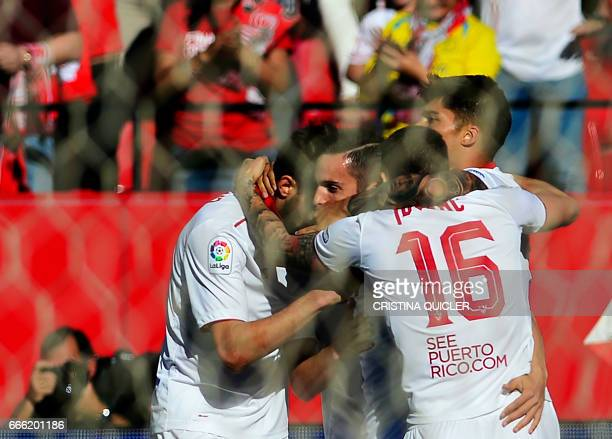 Sevilla's midfielder Pablo Sarabia celebrates a goal with teammates during the Spanish league football match Sevilla FC vs RC Deportivo de la Coruna...
