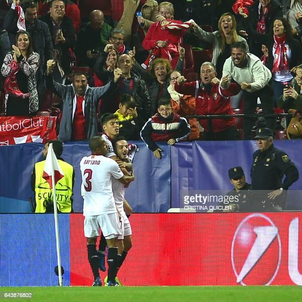 Sevilla's midfielder Pablo Sarabia celebrates after scoring a goal during the UEFA Champions League round of 16 second leg football match Sevilla FC...