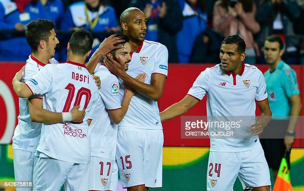 Sevilla's midfielder Pablo Sarabia celebrates with teammates after scoring during the Spanish league football match Sevilla FC vs SD Eibar on...