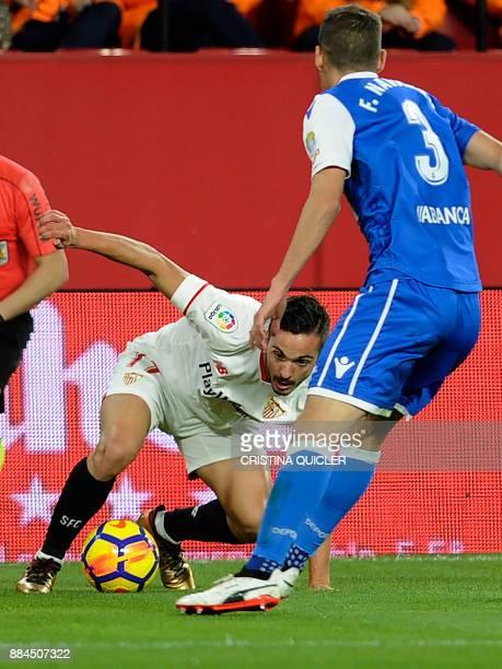 Sevilla's midfielder Pablo Sarabia challenges Deportivo La Coruna's Spanish defender Fernando Navarro during the Spanish league football match...