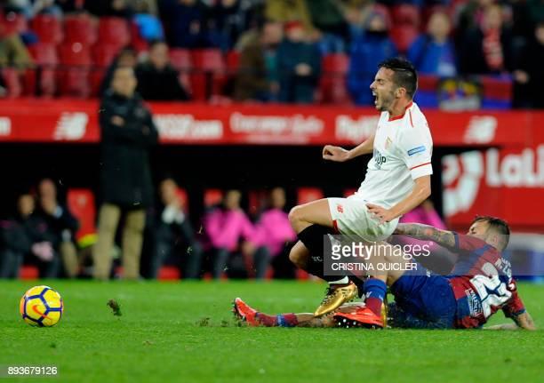 Sevilla's midfielder Pablo Sarabia vies with Levante's Spanish defender Antonio Luna during the Spanish league football match Sevilla FC vs Levante...