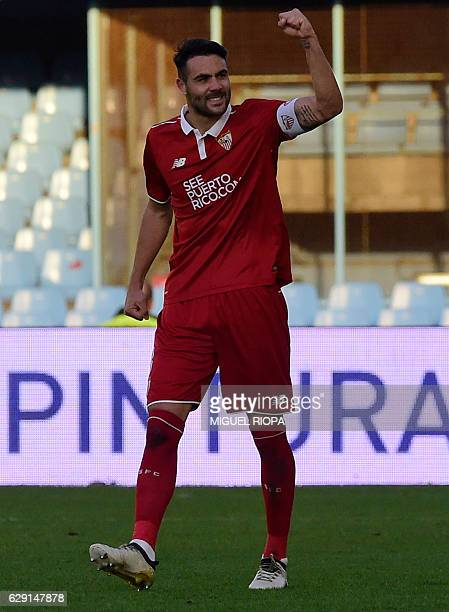 Sevilla's midfielder Vicente Iborra celebrates after scoring during the Spanish league football match RC Celta de Vigo vs Sevilla FC at the Balaidos...