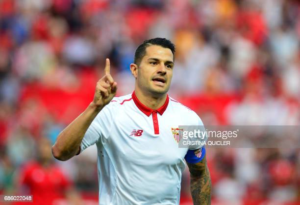 Sevilla's midfielder Vitolo celebrates after scoring a goal during the Spanish league football match Sevilla FC vs CA Osasuna at the Ramon Sanchez...