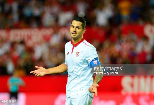 Sevilla's midfielder Vitolo celebrates after scoring a goal during the Spanish league football match Sevilla FC vs CA Osasuna at the Ramon Sanchez...