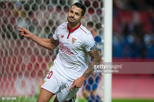 Sevilla's midfielder Vitolo celebrates after scoring during the Spanish league football match Sevilla FC vs FC Barcelona at the Ramon Sanchez Pizjuan...