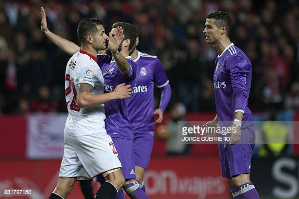 Sevilla's midfielder Vitolo speaks with Real Madrid's Portuguese forward Cristiano Ronaldo during the Spanish league football match Sevilla FC vs...