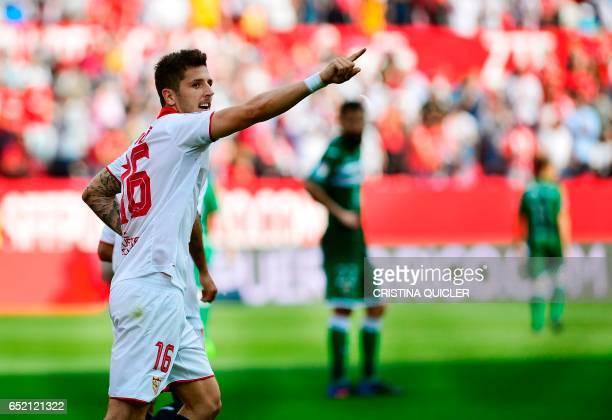 CORRECTION Sevilla's Montenegrin forward Stevan Jovetic celebrates after scoring during the Spanish league football match Sevilla FC vs Club...