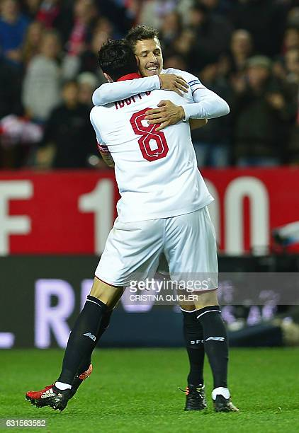 Sevilla's Montenegrin forward Stevan Jovetic celebrates with a teammate after scoring during the Spanish Copa del Rey round of 16 second leg football...