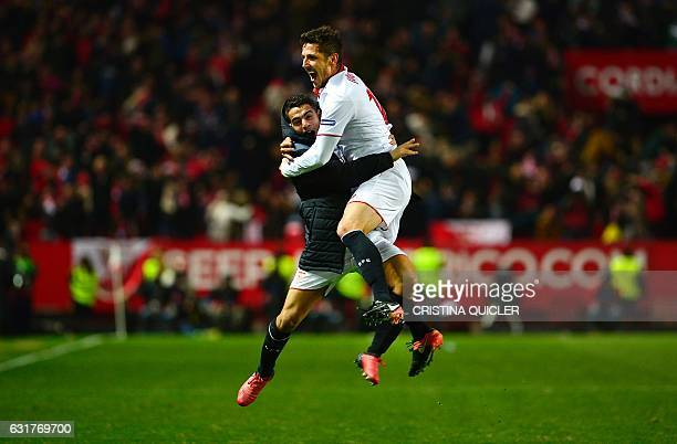 Sevilla's Montenegrin forward Stevan Jovetic celebrates with Sevilla's French forward Wissam Ben Yedder after scoring the 21 victory goal during the...