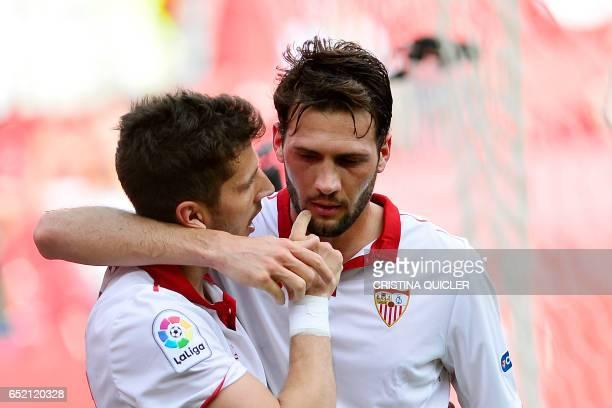 Sevilla's Montenegrin forward Stevan Jovetic celebrates with Sevilla's French forward Wissam Ben Yedder after scoring during the Spanish league...