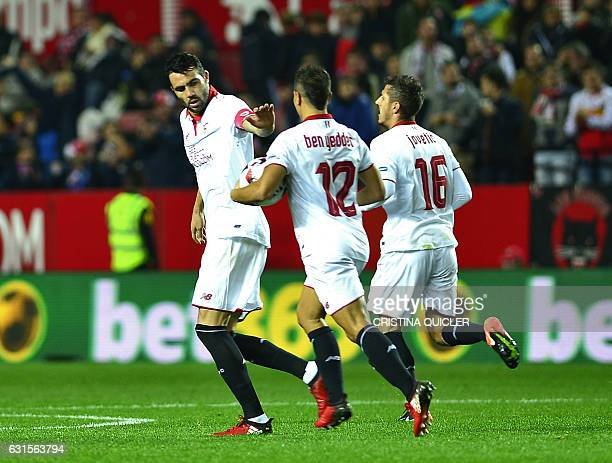 Sevilla's Montenegrin forward Stevan Jovetic celebrates with teammates after scoring during the Spanish Copa del Rey round of 16 second leg football...