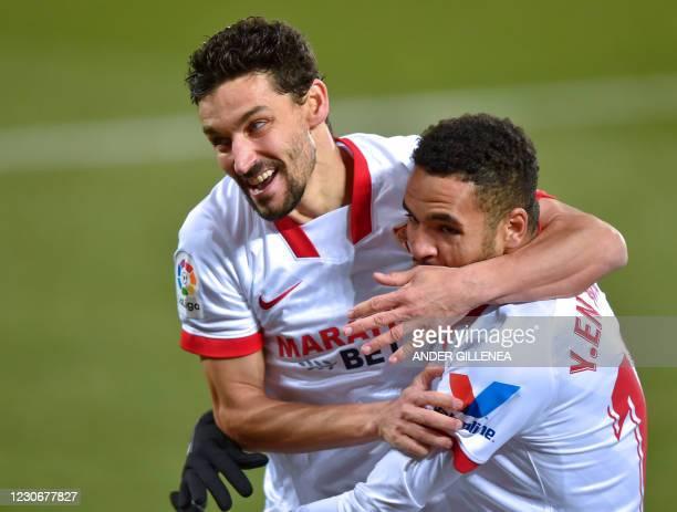 Sevilla's Moroccan forward Youssef En-Nesyri celebrates with teammate Spanish midfielder Jesus Navas after scoring a goal during the Spanish league...