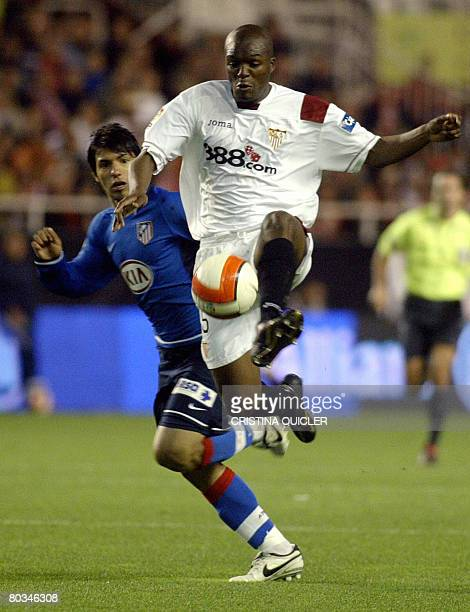 Sevilla's Mosquera vies with Atletico de Madrid's Aguero during a Spanish league football match at the Sanchez Pizjuan stadium in Sevilla on March 22...