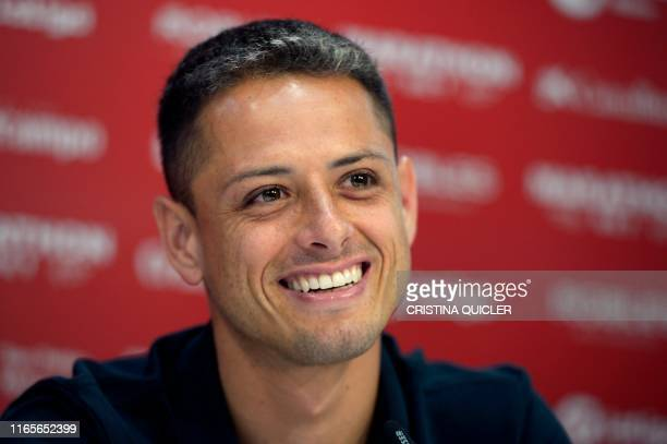 Sevilla's new player Mexican Javier Hernandez 'Chicharito' gives as press conference during his official presentation at the Sport City of Sevilla on...