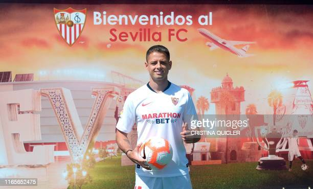 Sevilla's new player Mexican Javier Hernandez 'Chicharito' poses during his official presentation at the Sport City of Sevilla on September 2 2019