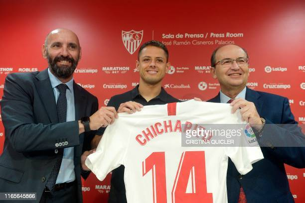 Sevilla's new player Mexican Javier Hernandez 'Chicharito' poses with Sevilla FC president Jose Castro and Sevilla's sporting director during...