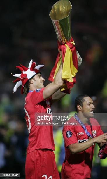 Sevilla's Ocio Aitor and Adriano celebrate winning the Uefa cup