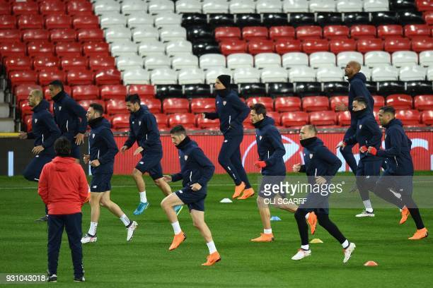 Sevilla's players attend a training session at Old Trafford stadium in Manchester north west England on March 12 on the eve of their UEFA Champions...