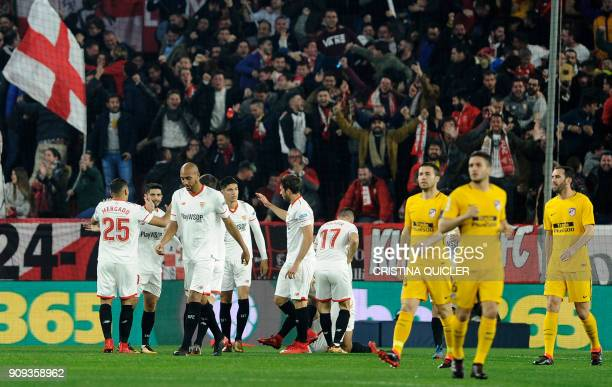 Sevilla's players celebrate a goal during the Spanish 'Copa del Rey' quarter-final second leg football match between Sevilla FC and Club Atletico de...