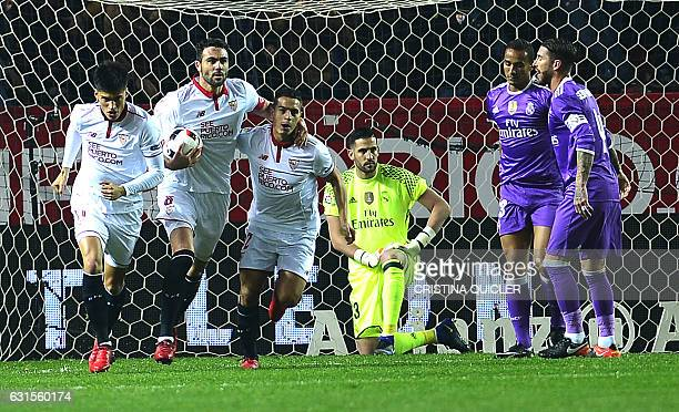 Sevilla's players celebrate after Real Madrid's Brazilian defender Danilo scored an own goal during the Spanish Copa del Rey round of 16 second leg...