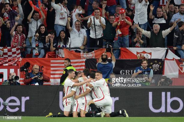 Sevilla's players celebrate after scoring a goal during the Spanish league football match between Sevilla FC and Real Betis at the Ramon Sanchez...