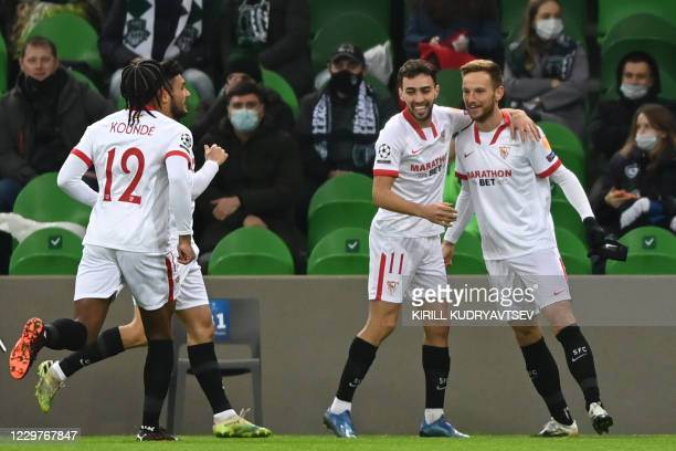 Sevilla's players celebrate after scoring a goal during the UEFA Champions League Group E second-leg football match between FK Krasnodar and Sevilla...
