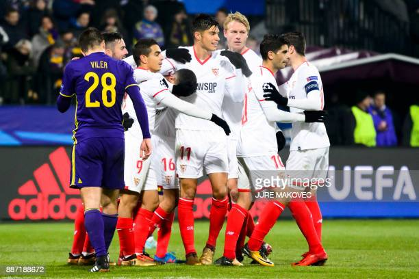 Sevilla's players celebrate after scoring a goal during the UEFA Champions League Group E football match between NK Maribor and Sevilla FC at the...