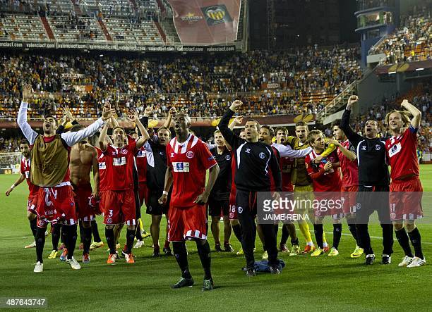 Sevilla's players celebrate at the end of the UEFA Europa League semifinal second leg football match Valencia CF vs FC Sevilla at the Mestalla...