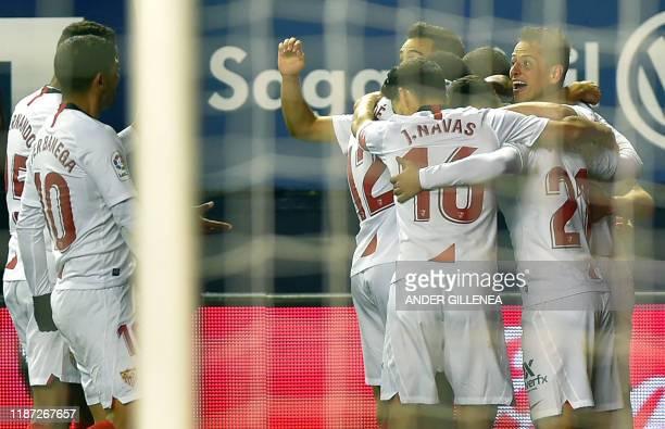 Sevilla's players celebrate teammate Spanish forward Munir El Haddadi's goal during the Spanish league football match between CA Osasuna and Sevilla...