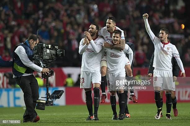 Sevilla's players celebrate their 21 victory at the end of the Spanish league football match Sevilla FC vs Real Madrid CF at the Ramon Sanchez...