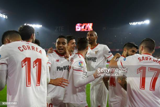 Sevilla's players celebrate their second goal during the Spanish 'Copa del Rey' quarterfinal second leg football match between Sevilla FC and Club...