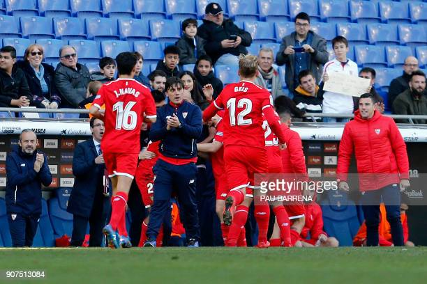 Sevilla's players celebrate their third goal with Italian coach Vincenzo Montella during the Spanish league football match between RCD Espanyol and...