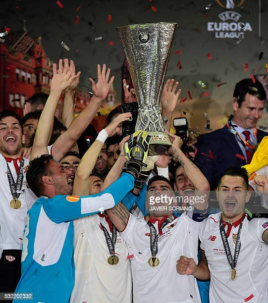 Sevilla's players celebrate with the trophy after winning the UEFA Europa League final football match between Liverpool FC and Sevilla FC at the St...